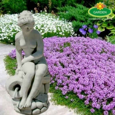 Kerti szobor nő sziklán ülő...